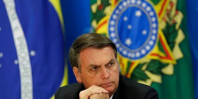 """Brazil's President Jair Bolsonaro, seen here, """"doesn't deserve"""" any respect, trust or dignity, the author said."""