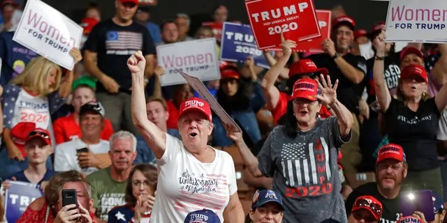 Supporters cheer at President Donald Trump's campaign rally, Thursday, Aug. 15, 2019, in Manchester, N.H. (AP Photo/Elise Amendola)