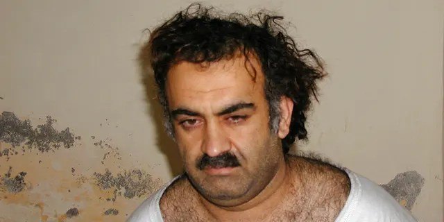 FILE - This Saturday March 1, 2003 photo obtained by The Associated Press shows Khalid Shaikh Mohammad, the alleged Sept. 11 mastermind, shortly after his capture during a raid in Pakistan. On Friday, Aug. 30, 2019, a military judge set Jan. 11, 2021 for the start of the long-stalled war crimes trial of the five men being held at the Guantanamo Bay prison on charges of planning and aiding the Sept. 11 terrorist attacks. (AP Photo)
