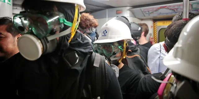 Protestors travel in a train en route to Causeway Bay in Hong Kong.