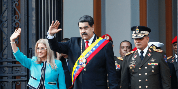 Venezuelan President Nicolas Maduro, center, and first lady Cilia Flores, wave in supporters as they leave the National Pantheon after participating in a ceremony for Caracas, Venezuela, Wednesday, August 7, 2019, for the 1800 Thirty-five Independence Battle gone.  Freezed all assets of the Maduro government in the US and even threatened to punish companies from third countries that continue to do business with their social administration.  The first couple is accompanied by Defense Minister General Paderino Lopez.  (AP Photo / Leonardo Fernandez)