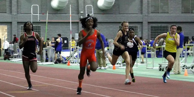 FILE - In this Feb. 7, 2019 file photo, Bloomfield High School transgender athlete Terry Miller, second from left, wins the final of the 55-meter dash over transgender athlete Andraya Yearwood, far left, and other runners in the Connecticut girls Class S indoor track meet at Hillhouse High School in New Haven, Conn. (AP Photo/Pat Eaton-Robb, File)