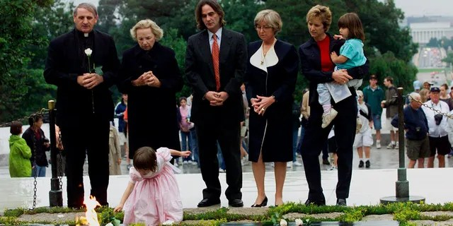 Robert F. Kennedy's granddaughter Saoirse Kennedy Hill places a white rose at the Eternal Flame, President John F. Kennedy's gravesite, at Arlington National Cemetery in Arlington, Va., June 6, 2000. Hill died Thursday at age 22.<br> (Associated Press)