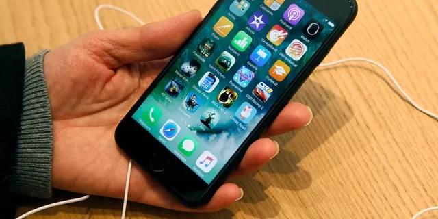 A customer checks an iPhone 7 in Paris, France.