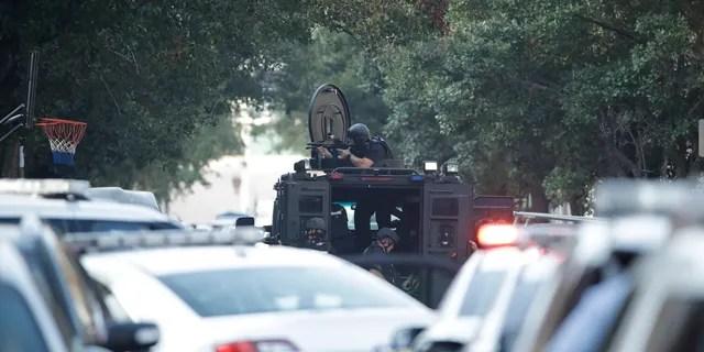 Law enforcement with a gun drawn in the Nicetown neighborhood of Philadelphia.