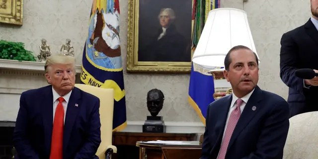 President Trump and Health and Human Services Secretary Alex Azar talk to the media in the Oval Office, Wednesday, Sept. 11, 2019, at the White House in Washington.(AP Photo/Evan Vucci)