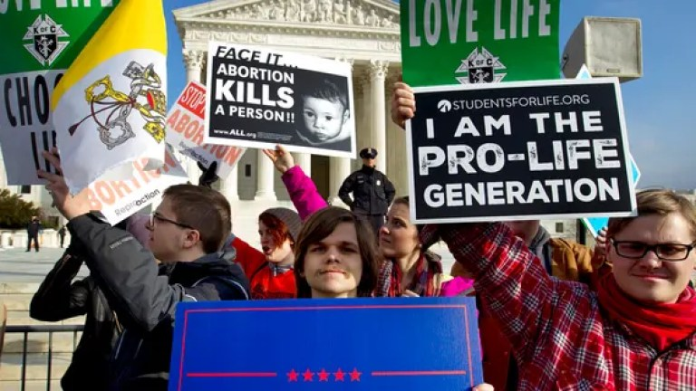 Anti-abortion activists protest outside of the U.S. Supreme Court, during last year's March for Life. (AP Photo/Jose Luis Magana, File)