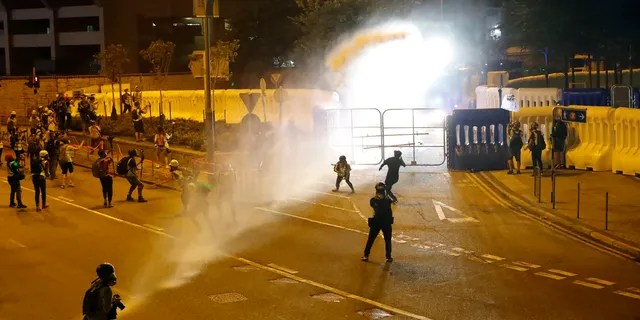 Police fire water cannon on protestors in Hong Kong Saturday. (AP Photo/Vincent Thian)