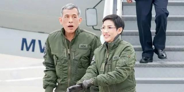 This undated photo posted Monday, Aug. 26, 2019, on the Thailand Royal Office website shows King Maha Vajiralongkorn with Major General Sineenatra Wongvajirabhakdi, the royal noble consort. (Thailand Royal Office via AP)