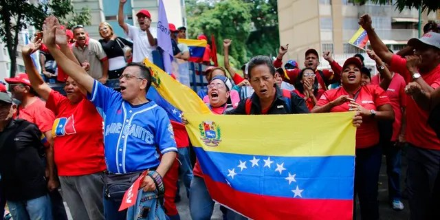 Government supporters chants slogans in favor of President Nicolas Maduro as they march in Caracas, Venezuela last month.