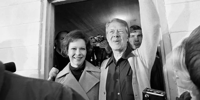 Jimmy Carter and his wife Rosalynn depart the Plains, Ga., polling place, Nov. 2, 1976. The candidate was the fifth person to vote in his precinct. The former governor will spend the day resting up for an evening in Atlanta where he will watch the returns. (AP Photo)