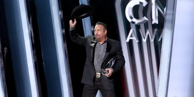 Garth Brooks accepts an award onstage during the 53rd annual CMA Awards at the Bridgestone Arena on November 13, 2019 in Nashville, Tennessee. (Photo by Terry Wyatt/Getty Images,)