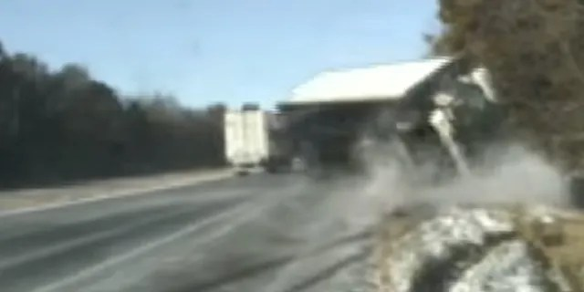 The truck nearly hit two Illinois state troopers and a woman they were assisting on the side of the road on Nov. 12, 2019.
