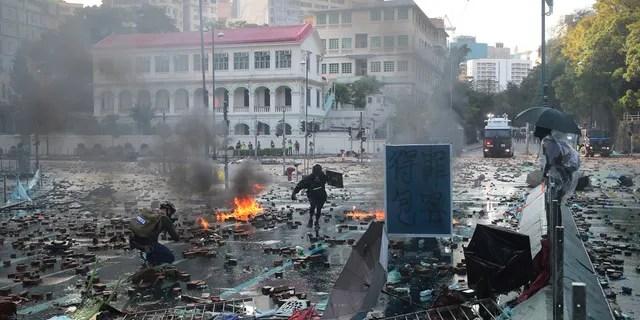 Protesters react during a confrontation at the Hong Kong Polytechnic University in Hong Kong, Sunday, Nov. 17, 2019.