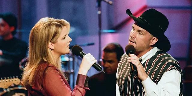 Trisha Yearwood and Garth Brooks performing in 1997.