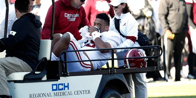 Alabama quarterback Tua Tagovailoa (13) is carted off the field after getting injured in the first half of an NCAA college football game against Mississippi State in Starkville, Miss., Saturday, Nov. 16, 2019.