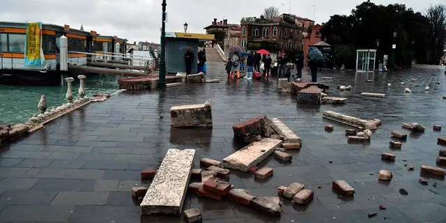 Parts of a dock lie damaged, in Venice, Italy, Wednesday, Nov. 13, 2019.
