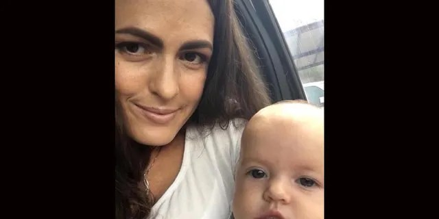 Christina Marie Langford Johnson, 31, holding her 7-month-old baby Faith, who miraculously survived the attack.