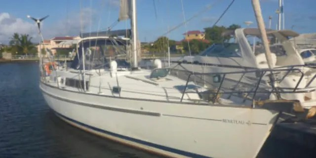 The Coast Guard said three people were on board the 40-foot sailboat named Dove.