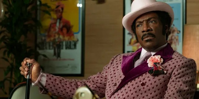 "This image released by Netflix shows Eddie Murphy in a scene from ""Dolemite Is My Name."" On Monday, Dec. 9, 2019, the film was nominated for a Golden Globe for best comedy film and Murphy was nominated for best actor in a motion picture comedy for his role in the film."