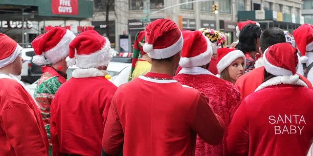 Thousands dressed up as Santa Claus, reindeer, elves and other festive holiday characters participated in New York City's SantaCon on Saturday.