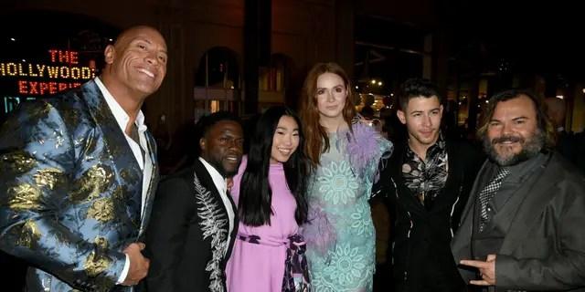 "From left to right: Dwayne ""The Rock"" Johnson, Kevin Hart, Awkwafina, Karen Gillan, Nick Jonas and Jack Black at the premiere of ""Jumanji: The Next Level."" (Photo by Kevin Winter/Getty Images)"