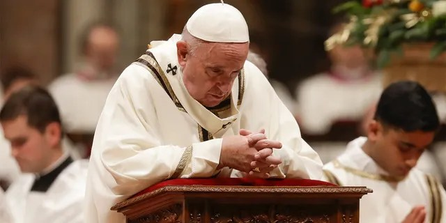 Pope Francis prays as he celebrates Christmas Eve Mass in St. Peter's Basilica at the Vatican, Tuesday, Dec. 24, 2019. (AP Photo/Alessandra Tarantino)