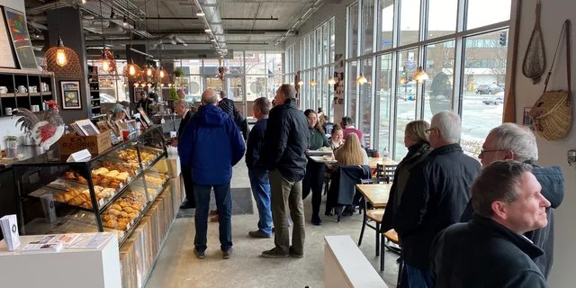 The lunchtime crowd arrives at the Scenic Route Bakery in the East Village neighborhood of Des Moines, Iowa on Jan. 15, 2020