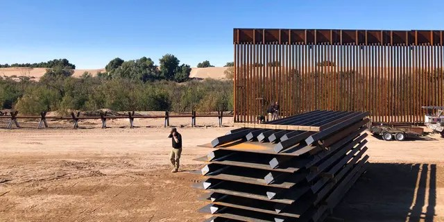 Crews working at a portion of border wall under construction in Yuma, Ariz.