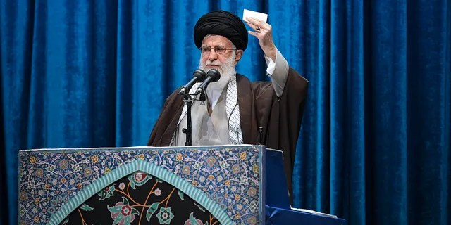 """In this photo released by the official website of the office of the Iranian supreme leader, Supreme Leader Ayatollah Ali Khamenei delivers his sermon in the Friday prayers at Imam Khomeini Grand Mosque in Tehran, Iran, Friday, Jan. 17, 2020. Iran's supreme leader said President Donald Trump is a """"clown"""" who only pretends to support the Iranian people but will """"push a poisonous dagger"""" into their backs, as he struck a defiant tone in his first Friday sermon in Tehran in eight years. (Office of the Iranian Supreme Leader via AP)"""