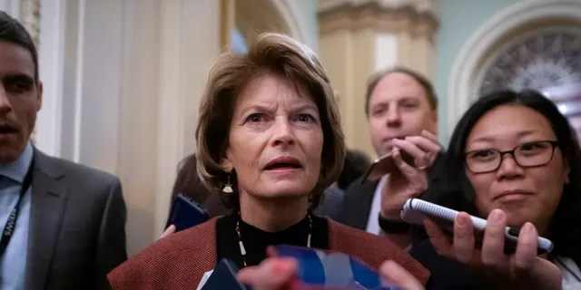 Sen. Lisa Murkowski, R-Alaska, arrives at the Senate for the start of the impeachment trial of President Donald Trump on charges of abuse of power and obstruction of Congress, at the Capitol in Washington, Tuesday, Jan. 21, 2020. (AP Photo/J. Scott Applewhite)