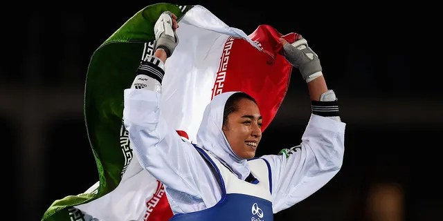 Kimia Alizadeh Zenoorin of Iran celebrates after defeating Nikita Glasnovic of Sweden during a women's Bronze Medal Taekwondo contest at the 2016 Summer Olympics, Aug. 18, 2016 in Rio de Janeiro, Brazil. (Getty Images)