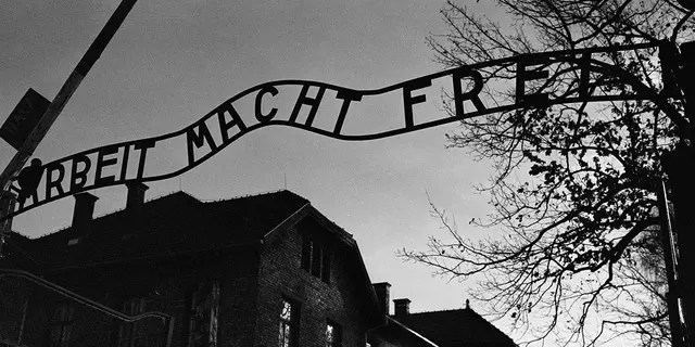 "The main entrance at the former Nazi death camp of Auschwitz in Oswiecim, Poland, with the inscription, 'Arbeit Macht Frei', which translates into English as '""Work will set you Free"". (AP Photo/Markus Schreiber)"