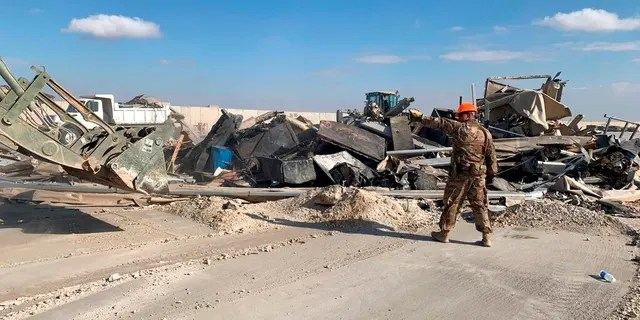 U.S. soldiers clear rubble from a site of Iranian bombing at Ain al-Asad airbase in Anbar, Iraq, on Jan. 13. Ain al-Asad airbase was struck by a barrage of Iranian missiles, in retaliation for the U.S. drone strike that killed top Iranian commander, Gen. Qassem Soleimani. (AP)
