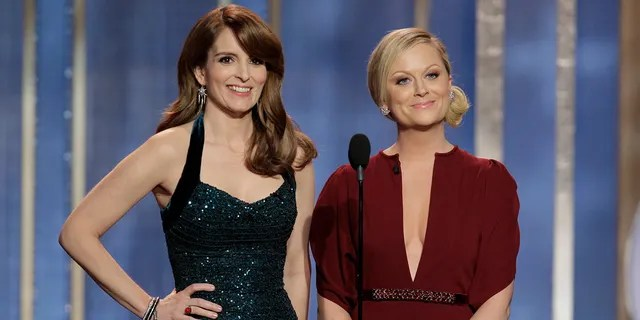 """Tina Fey, left, will reunite with fellow """"Saturday Night Live"""" alum AmyPoehlerto co-host the Golden Globes again. (Getty Images)"""