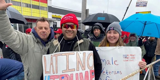 Trump supporter Jay McDonald of North Providence, RI, (on the left) stands outside of the SNHU Arena in Manchester, NH, ahead of the president's re-election rally on the eve of the NH primary, on Feb. 10, 2020