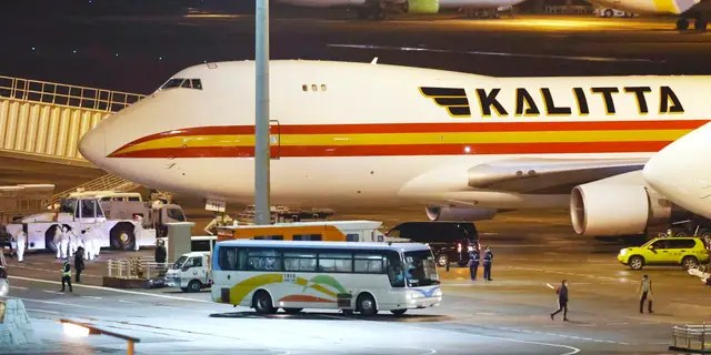 A bus carrying U.S. passengers who were aboard the quarantined cruise ship the Diamond Princess arriving at Haneda Airport in Tokyo. (Sadayuki Goto/Kyodo News via AP)
