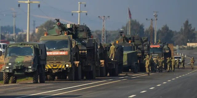 FILE - In this Feb. 14, 2020, file photo, Turkish troops and artillery prepare to enter Syria, in Reyhanli, Hatay, Turkey. (AP Photo, File)