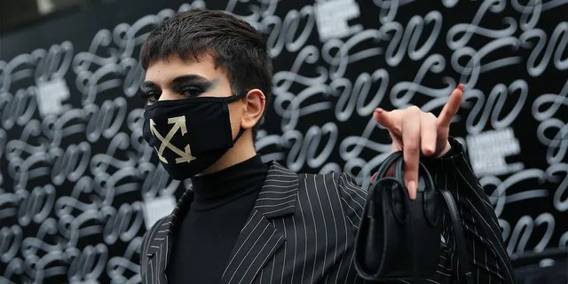 A model wears a face mask by On/Off designer during London Fashion Week February 2020 outside the BFC Show Space Show in London. (Photo by Isabel Infantes/PA Images via Getty Images)