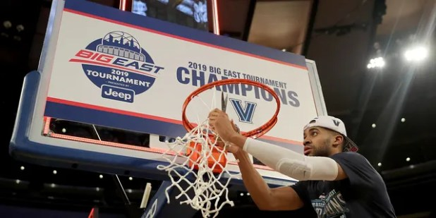 Phil Booth # 5 of the Villanova Wildcats cuts the net after a 74-72 win over the Seton Hall Pirates after the Big East Championship Game at Madison Square Garden on March 16, 2019 in New York City.  (Photo by Elsa / Getty Images)