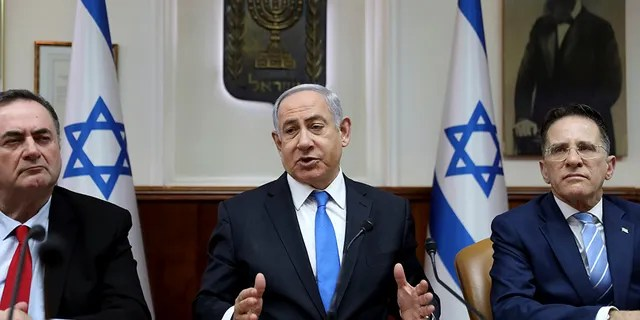 Israeli Prime Minister Benjamin Netanyahu chairs the weekly cabinet meeting, in Jerusalem, Sunday, Feb. 16, 2020.