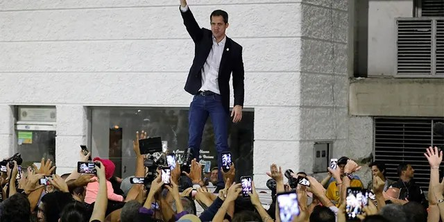 Opposition leader Juan Guaido waves to supporters during a rally at Bolivar Plaza in Chacao, a municipality of Caracas, Venezuela, on Tuesday.