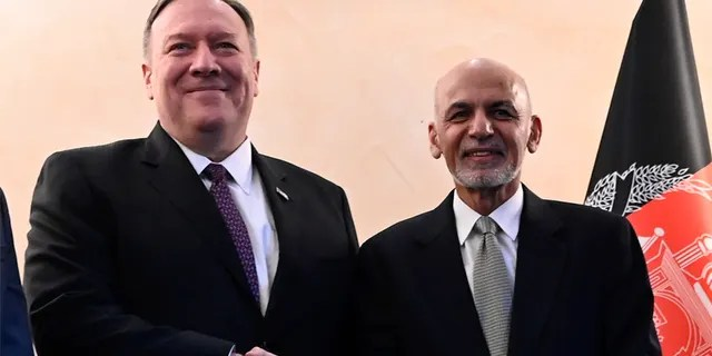 U.S. Secretary of State Mike Pompeo, left, shakes hands with Afghan President Ashraf Ghani, during the 56th Munich Security Conference in Munich, Germany, on Friday. (AP)