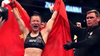 Zhang Weili, Israel Adesanya keep title belts at UFC 248