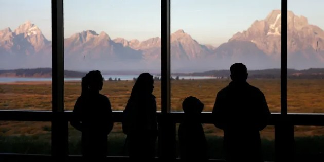 Cory Gardner FILE - In this Aug. 28, 2016 file photo, visitors watch the morning sun illuminate the Grand Tetons from within the Great Room at the Jackson Lake Lodge in Grand Teton National Park, north of Jackson, Wyo.  (AP Photo/Brennan Linsley)