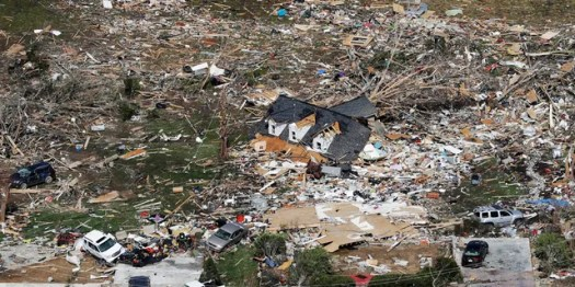 The remains of homes shattered by storms are scattered near Cookeville, Tenn., Tuesday, March 3, 2020.