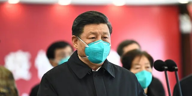 In this photo released by China's Xinhua News Agency, Chinese President Xi Jinping talks by video with patients and medical workers at the Huoshenshan Hospital in Wuhan in central China's Hubei Province earlier this month. China said Thursday that no new coronavirus cases were reported in Wuhan, the epicenter of the pandemic. (Xie Huanchi/Xinhua via AP)