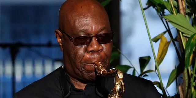 "Saxophonist Manu Dibango performs during Franck Sorbier's Haute Couture Spring-Summer 2018 fashion collection in Paris. Renowned jazz man Manu Dibango, to many the beloved ""Papy Groove"" who served as an inspiration and pioneer in his art, died on Tuesday from the coronavirus, his official Facebook page announced."