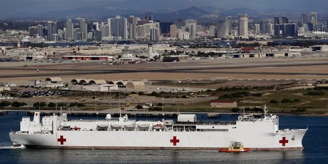 The USNS Mercy hospital ship leaves port Monday, March 23, 2020, in San Diego.
