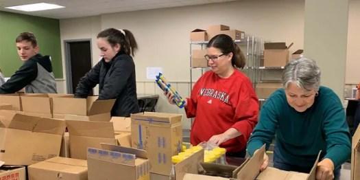 Volunteers at Food Bank of the Heartland pack coronavirus emergency boxes. (Feeding America)